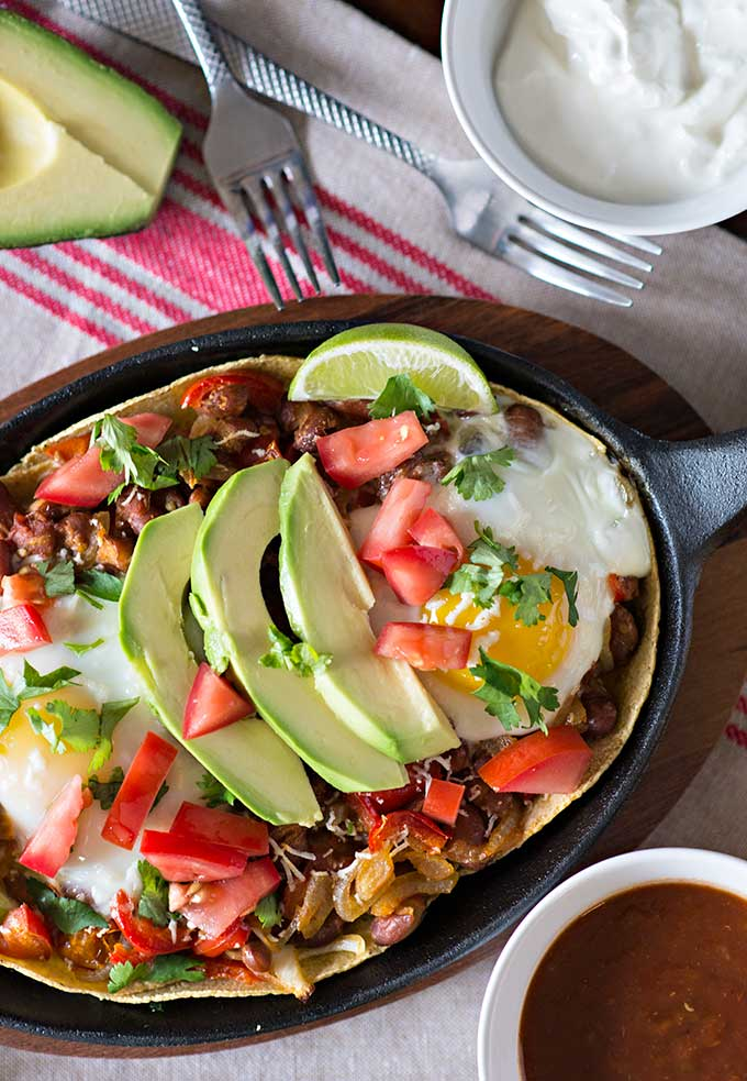 Avocado and fresh salsa on top of Huevos Rancheros breakfast recipe