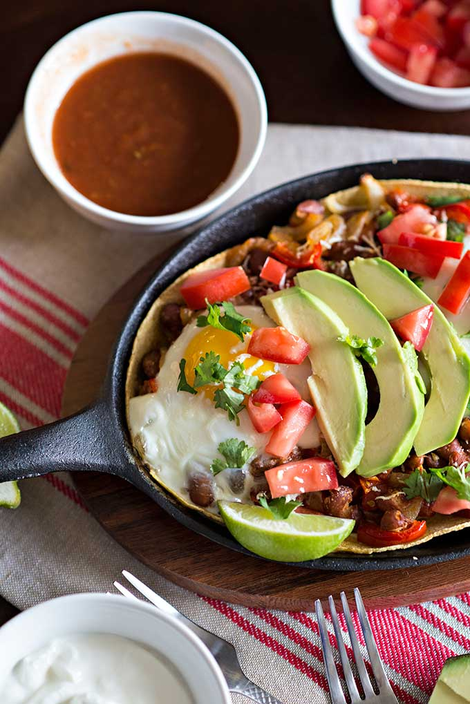 avocado slices on top of Huevos Rancheros mexican breakfast