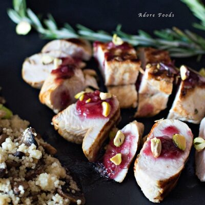 Barbecued turkey breast with cranberry orange sauce and mushroom couscous