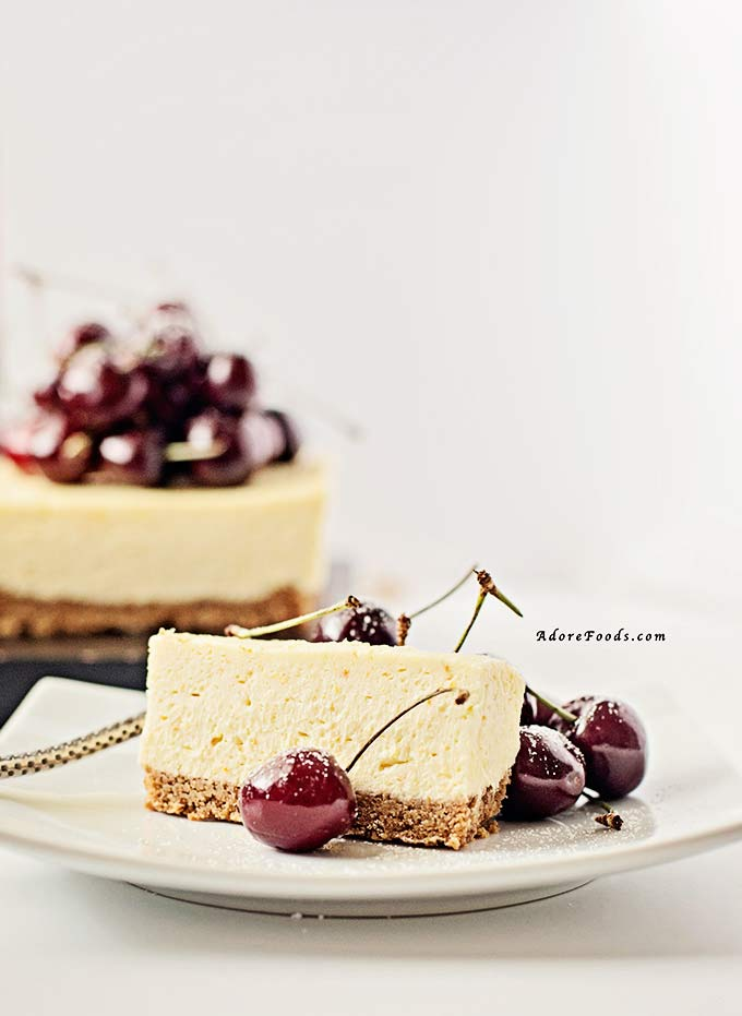 a slice of no bake cherry cheesecake on a plate