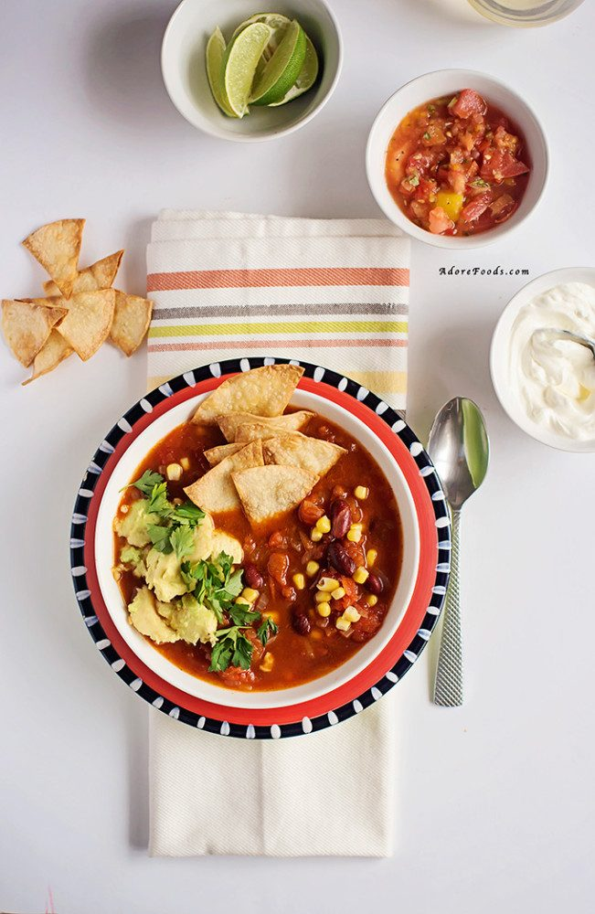 Mexican tortilla soup with avocado and tomato salsa