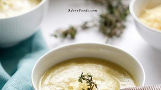 Creamy artichoke soup with parmesan and sour cream