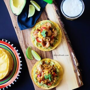 Spicy Chipotle Shrimp & Corn Tostadas - crunchy corn tortillas, creamy adobo guacamole and juicy shrimp and corn topping. One of the best tostadas I have ever eaten.