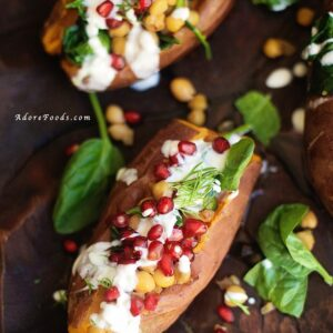 Stuffed sweet potatoes with chickpeas, spinach and pomegranate