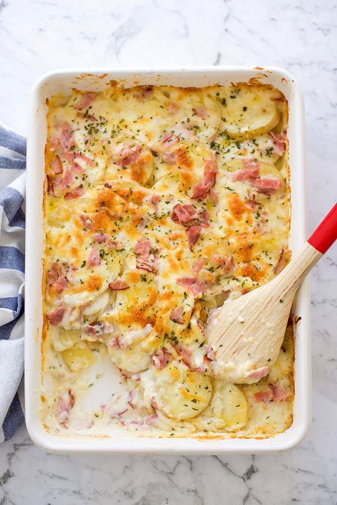 Tray with homemade scalloped potatoes and ham